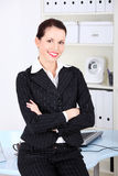 Businesswoman with crossed hands. Royalty Free Stock Image