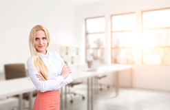 Businesswoman with crossed hands Royalty Free Stock Images