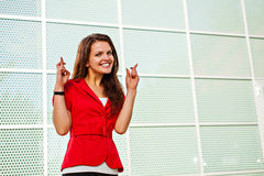 Businesswoman crossing fingers stock photo