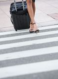 Businesswoman crossing zebra crossing Stock Photo