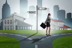 The businesswoman at crossroads betweem buying and renting. Businesswoman at crossroads betweem buying and renting royalty free stock photography