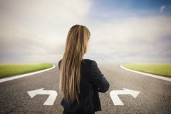 Businesswoman at a crossroads. She chooses the correct way. Concept of decision in business. Life stock image