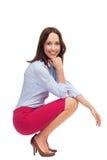 Businesswoman crouching Royalty Free Stock Image