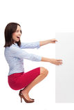 Businesswoman crouching by blank board Stock Images