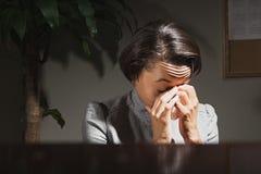 Businesswoman crying Stock Photo
