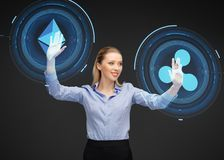 Businesswoman with cryptocurrency holograms stock photos