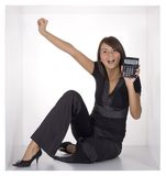 Businesswoman in the cube. Businesswoman with calculator in the cramped white cube Royalty Free Stock Photo