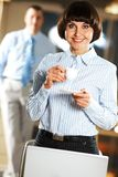 Businesswoman with cup Stock Photography