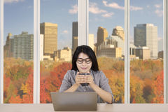 Businesswoman with cup of coffee and laptop Stock Images
