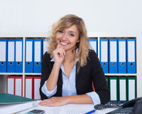 Businesswoman with curly blond hair laughing at camera Royalty Free Stock Photo