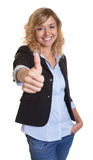 Businesswoman with curly blond hair showing thumb up Royalty Free Stock Photography