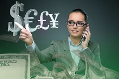 The businesswoman with currencies in business concept Royalty Free Stock Image