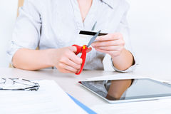 Businesswoman cutting credit card Royalty Free Stock Photography