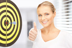 Businesswoman with dart and target Royalty Free Stock Image