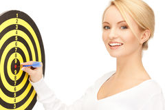 Businesswoman with dart and target Royalty Free Stock Images