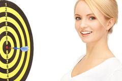 Businesswoman with dart and target Stock Photography