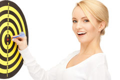 Businesswoman with dart and target Stock Images
