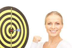 Businesswoman with dart and target Stock Photos