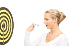 Businesswoman with dart and target Stock Photo