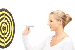 Businesswoman with dart and target Royalty Free Stock Photos