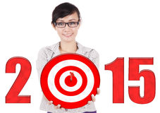 Businesswoman with dartboard of 2015 Stock Photo
