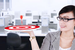 Businesswoman with dartboard Royalty Free Stock Photos