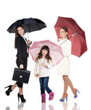 Businesswoman with daughter under umbrellas Royalty Free Stock Images