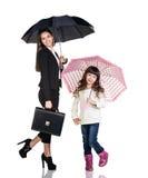 Businesswoman with daughter under umbrellas Stock Photo