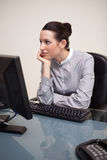 Businesswoman daydreaming at workplace Royalty Free Stock Image