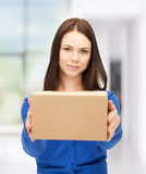 Businesswoman delivering box. Picture of attractive businesswoman delivering box royalty free stock photos