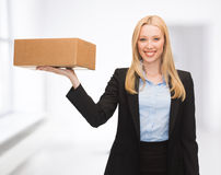 Businesswoman delivering cardboard box Stock Images