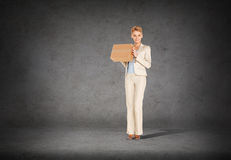 Businesswoman delivering cardboard box Royalty Free Stock Photos