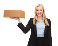 Businesswoman delivering cardboard box Stock Photography