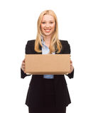 Businesswoman delivering cardboard box Stock Photo