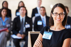 Businesswoman Delivering Presentation At Conference stock photography