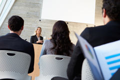 Businesswoman Delivering Presentation At Conference Royalty Free Stock Image