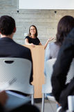 Businesswoman Delivering Presentation At Conference Royalty Free Stock Photography