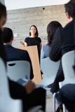 Businesswoman Delivering Presentation At Conference. Talking Royalty Free Stock Images