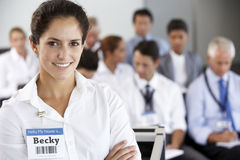 Businesswoman Delivering Presentation At Conference stock photos