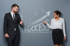 Businesswoman demonstrates success to her partner royalty free stock photo