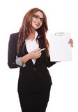 Businesswoman demonstrating with clipboard Royalty Free Stock Image