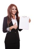 Businesswoman demonstrating with clipboard Royalty Free Stock Photography