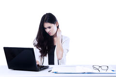 Businesswoman depressed looking at laptop Stock Photography