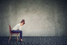 Businesswoman in depression sitting on chair stock photography