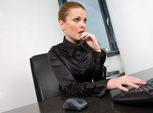 Businesswoman at desk Stock Images