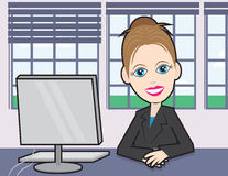 Businesswoman at a desk Stock Images