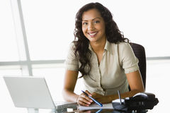 Businesswoman at desk. With laptop Royalty Free Stock Photo