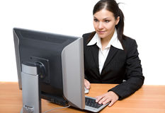 Businesswoman at desk Royalty Free Stock Photos