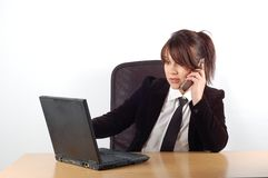 Businesswoman at desk #8 royalty free stock images