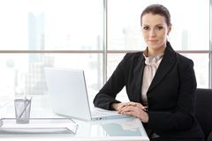 Businesswoman at desk with computer Stock Photos